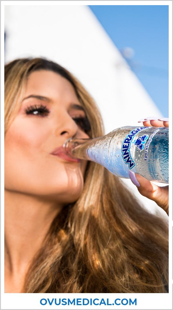 OVUS MEDICAL WOMAN DRINKING WATER